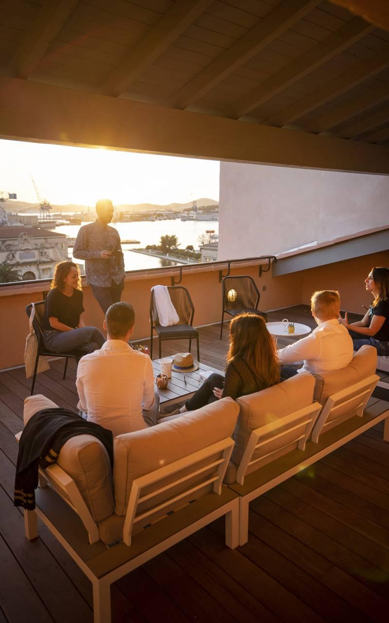 People on the terrace, meeting Toulon, l'Eautel
